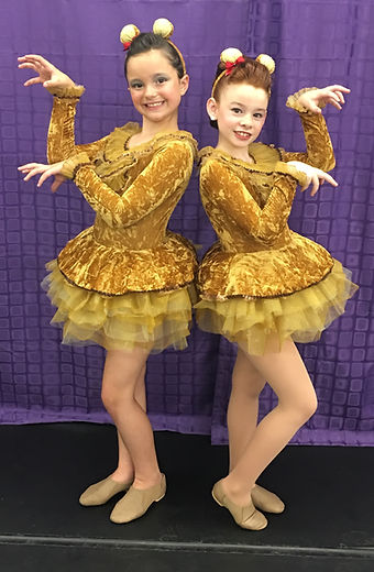 little girls posing with dance costume