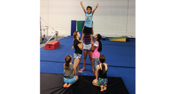 Kids doing a cheers pyramid