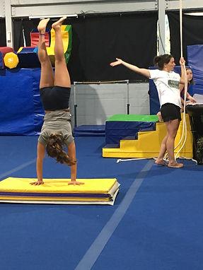 girl learning handstands