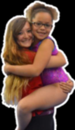 Coach hugging little girl