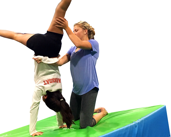 coach spotting a gymnast