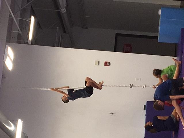 kid climbing rope