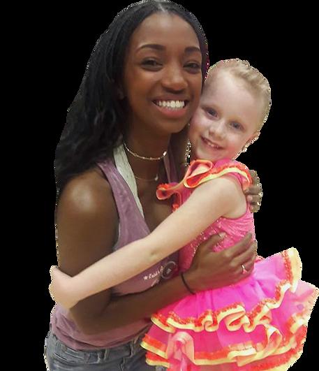 Staff hugging little girl
