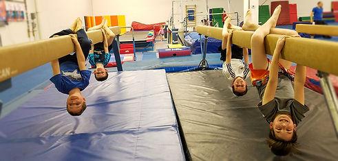 kids upside down on the beam