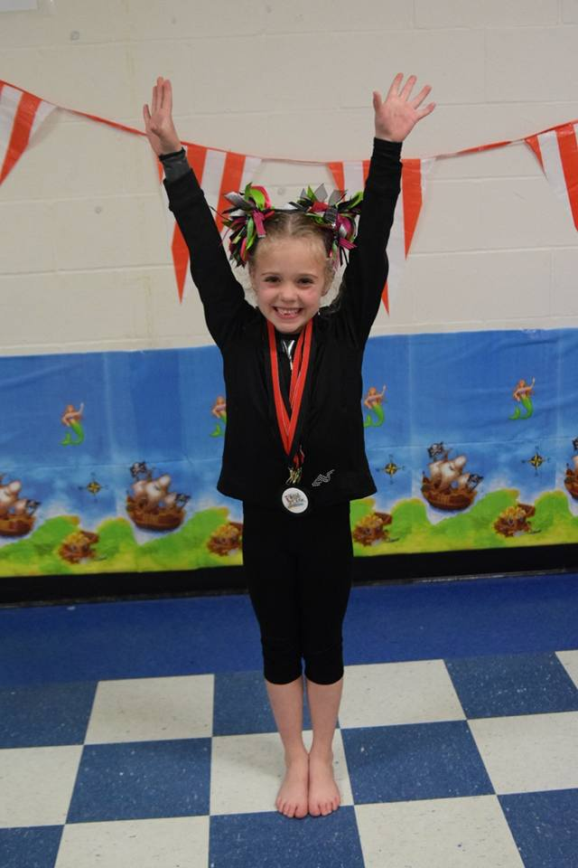 Excited girl with a medal