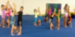 kids spoting handstands