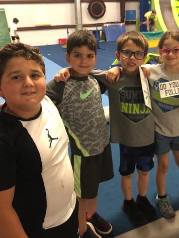4 kids arms around.jpg