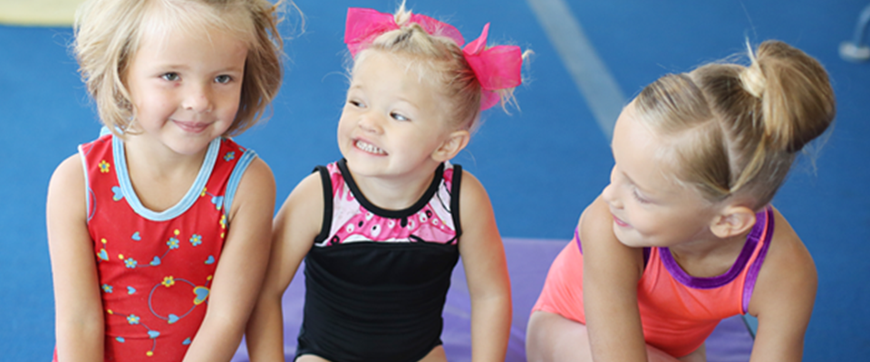 pre school girls learning gymnastics