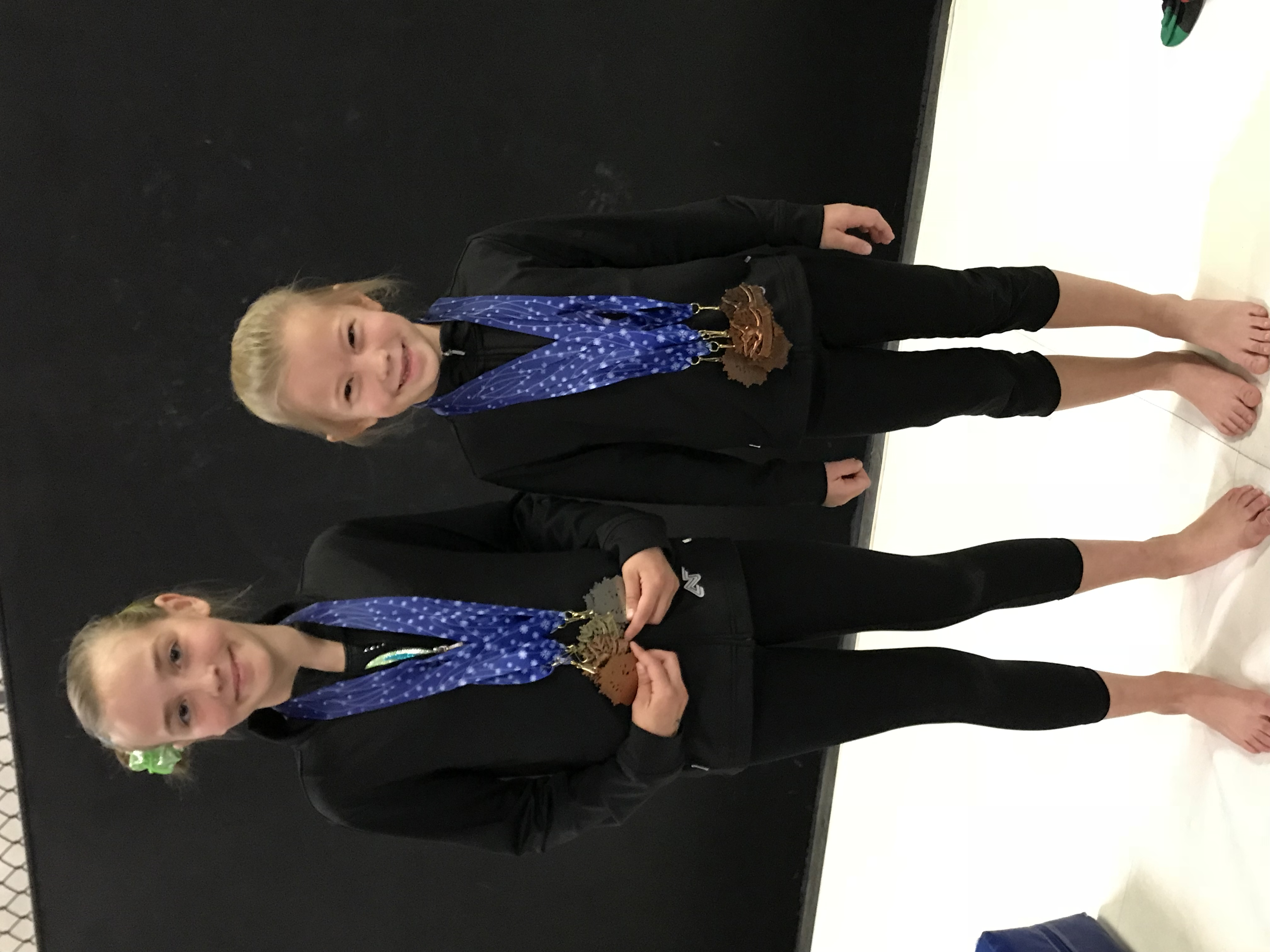 Girls with couple competition medals