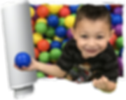 little boy enjoying the ball pit