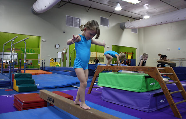 girl walking on a beam