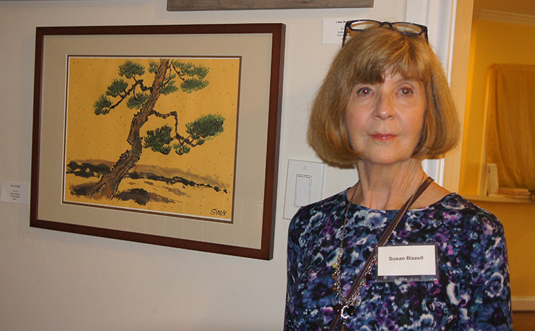 Susan Bizzell by her painting