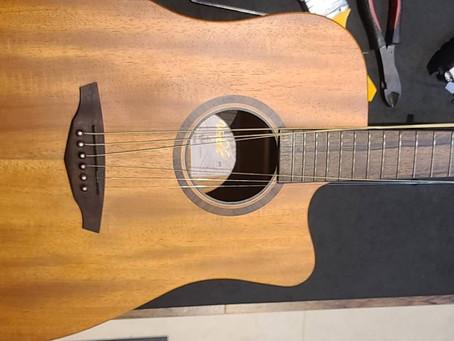 木吉他保養_吉他弦距調整找可洛音樂_新竹保養吉他
