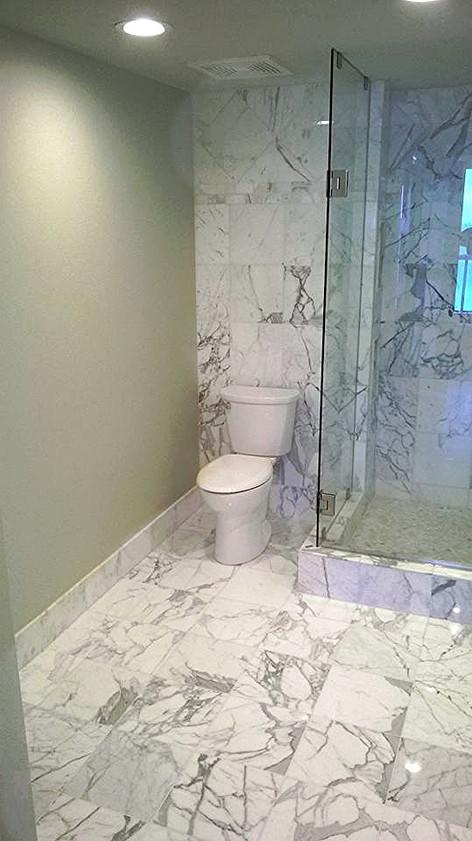 "Bathroom Floors & Shower Walls done in a ""Marble Carrara Look"" Porcelain Tile"