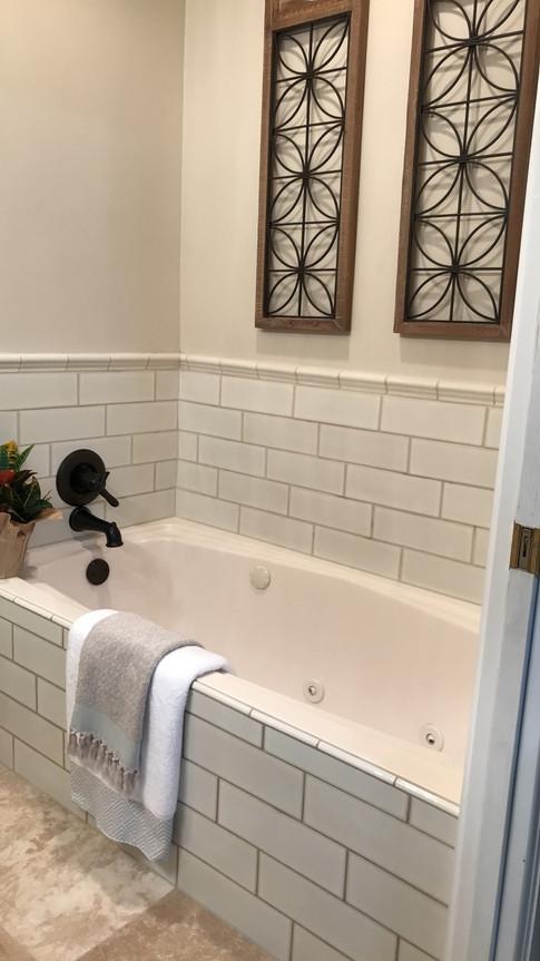 "Tub surround using ""Highland Park"" 4x16 Antique White Subway Tiles"