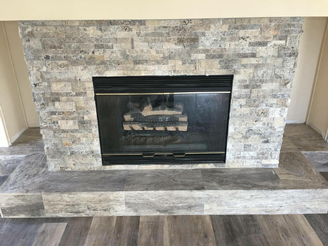 Fireplace Face: 6x24 Silverado Travertine Ledger Panels  Hearth: 12x24 Silverado Travertine Veincut