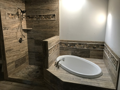 Shower Wall & Tub Surround: 12x24 Silverado Veincut Travertine  Shower Floor: 2x2 Silverado Travertine Tumbled Mosaic  Band: Silverado Travertine Cambered Mosaic