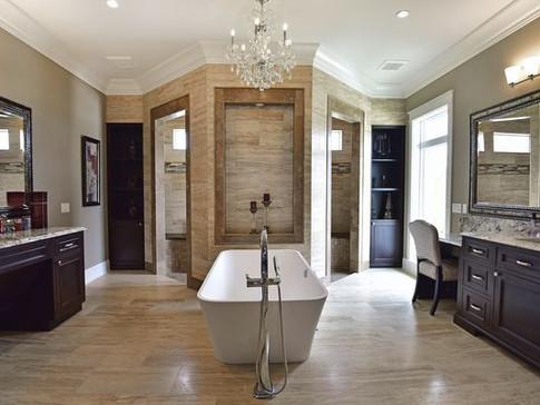 Shower Walls & Bathroom Floors: 12x24 Ivory Veincut Travertine  Shower Trimmed: Noce' Travertine