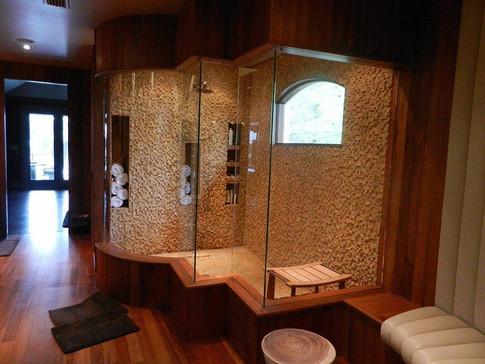 Shower Wall: Golden Travertine 1x1 Splitface Mosaics  Shower Floor: Giallo 1x1 Tumbled Mosaics