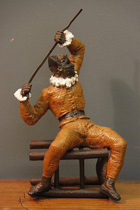 Cold Painted Bronze Jester on a tipped over stool.