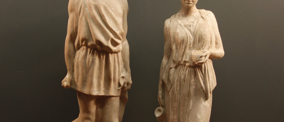 Two Plaster Figurines Male and Female.