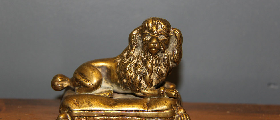 Miniture brass dog on a cushion