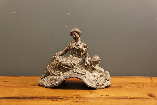 Bronze Reclining Lady Surrounded by Books and a Globe.