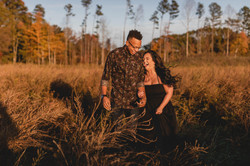 Couple laughs together during Charlotte, North Carolina engagement session