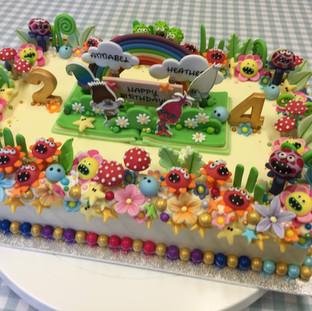 A Trolls themed birthday cake