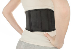 woman-wearing-back-support-belt-isolated-on-white-73420585