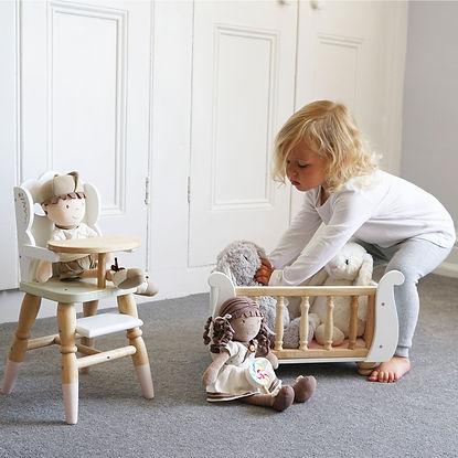 TV600-sleigh-doll-cot-girl-putting-bunny