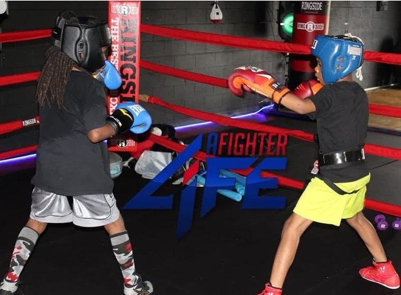 A Fighter kids sparring.jpeg