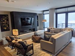 "606 East - Living Room w/ 65"" Smart TV"