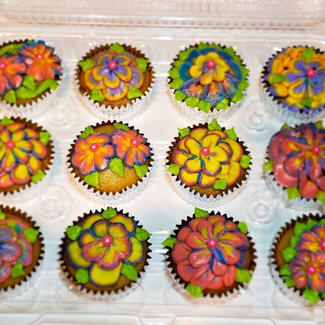 Beautiful rainbow floral cupcakes for a
