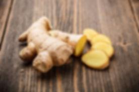 Ginger root sliced on wooden table.jpg