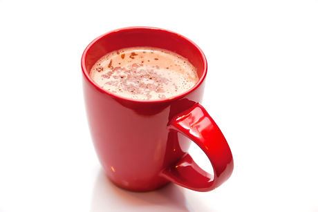 Hot chocolate in a red cup isolated on w
