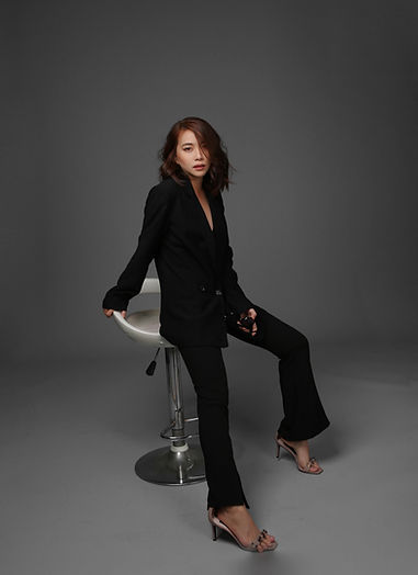 woman-in-black-blazer-and-black-pants-si