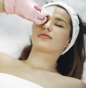 woman-getting-a-facial-treatment-3985321