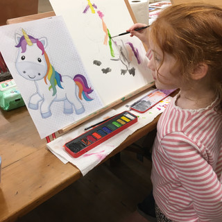 Livvy painting her Unicorn