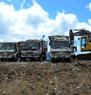 Trucks sorting recycled goods