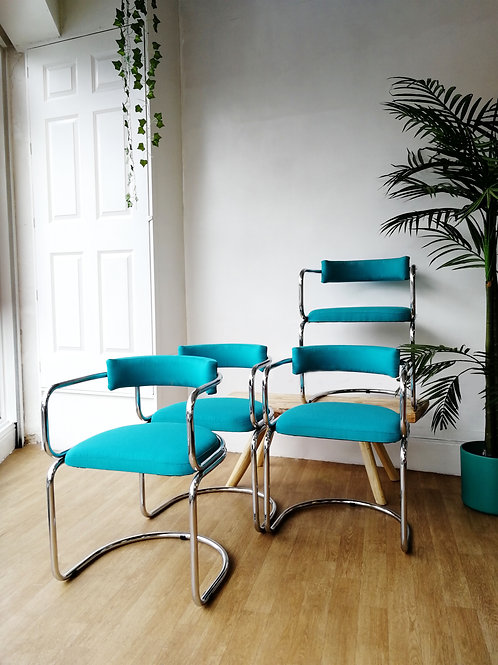 A set of mid-century modern chrome dining chairs