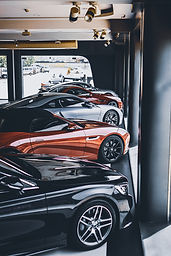 five-assorted-color-cars-parked-inside-r