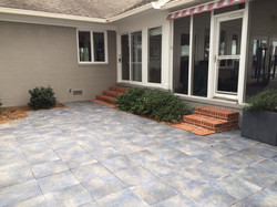 Before: outdoor tile and brick steps