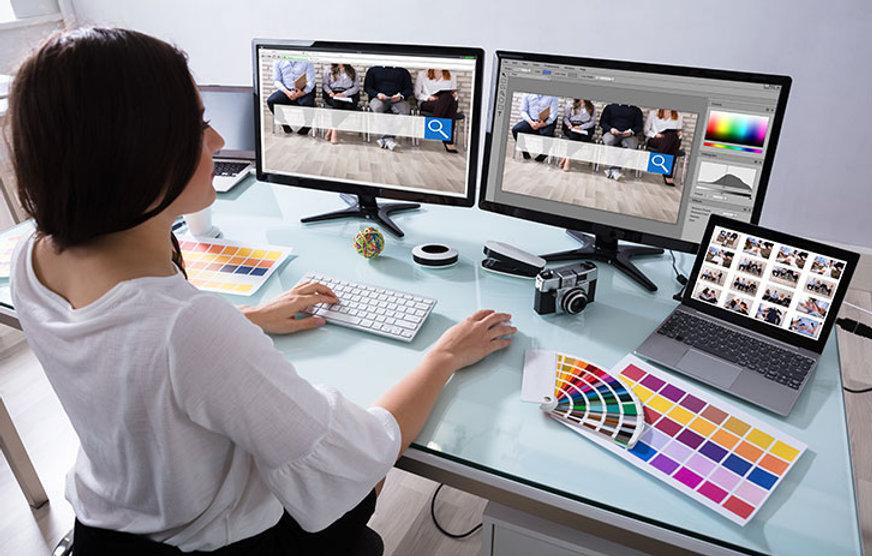 female-designing-on-multiple-computer-di