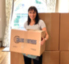 Bari Goldstein holding moving box