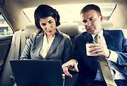 business people working inside car service from orlando limo