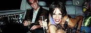 couple celebrating in orlando limo