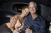 Senior couple celebrating in a limousine from orlando limo service
