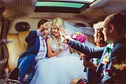 Groom and bride inside a limo during their wedding transportation in Orlando