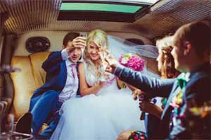 Groom and Bride inside a Orlando Limo celebrating with friends the wedding limo servce